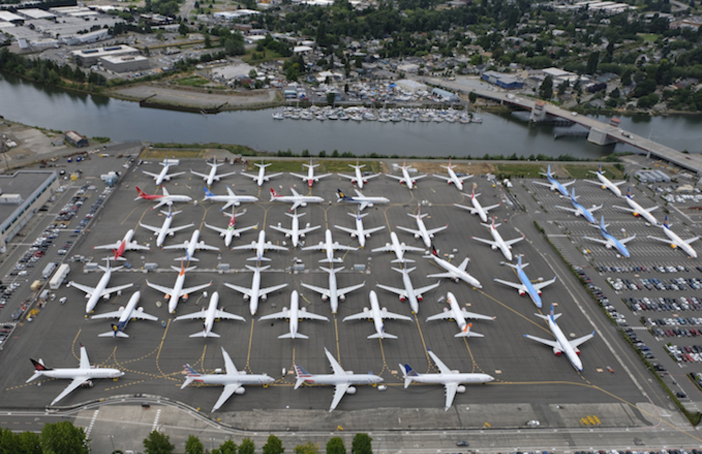 Boeing 737 MAX airplanes are stored on employee parking lots near Boeing Field.