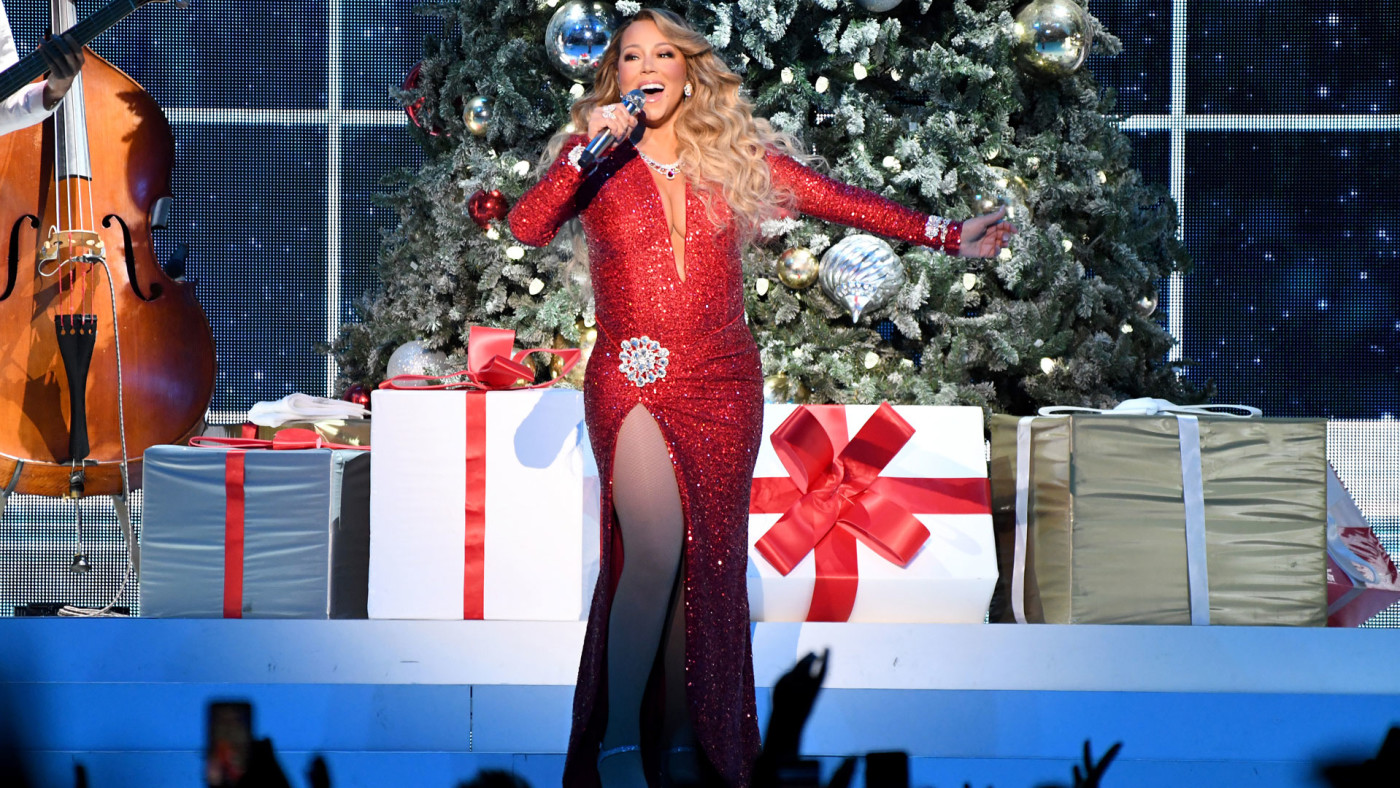 "Mariah Carey performs onstage during her ""All I Want For Christmas Is You"" tour."