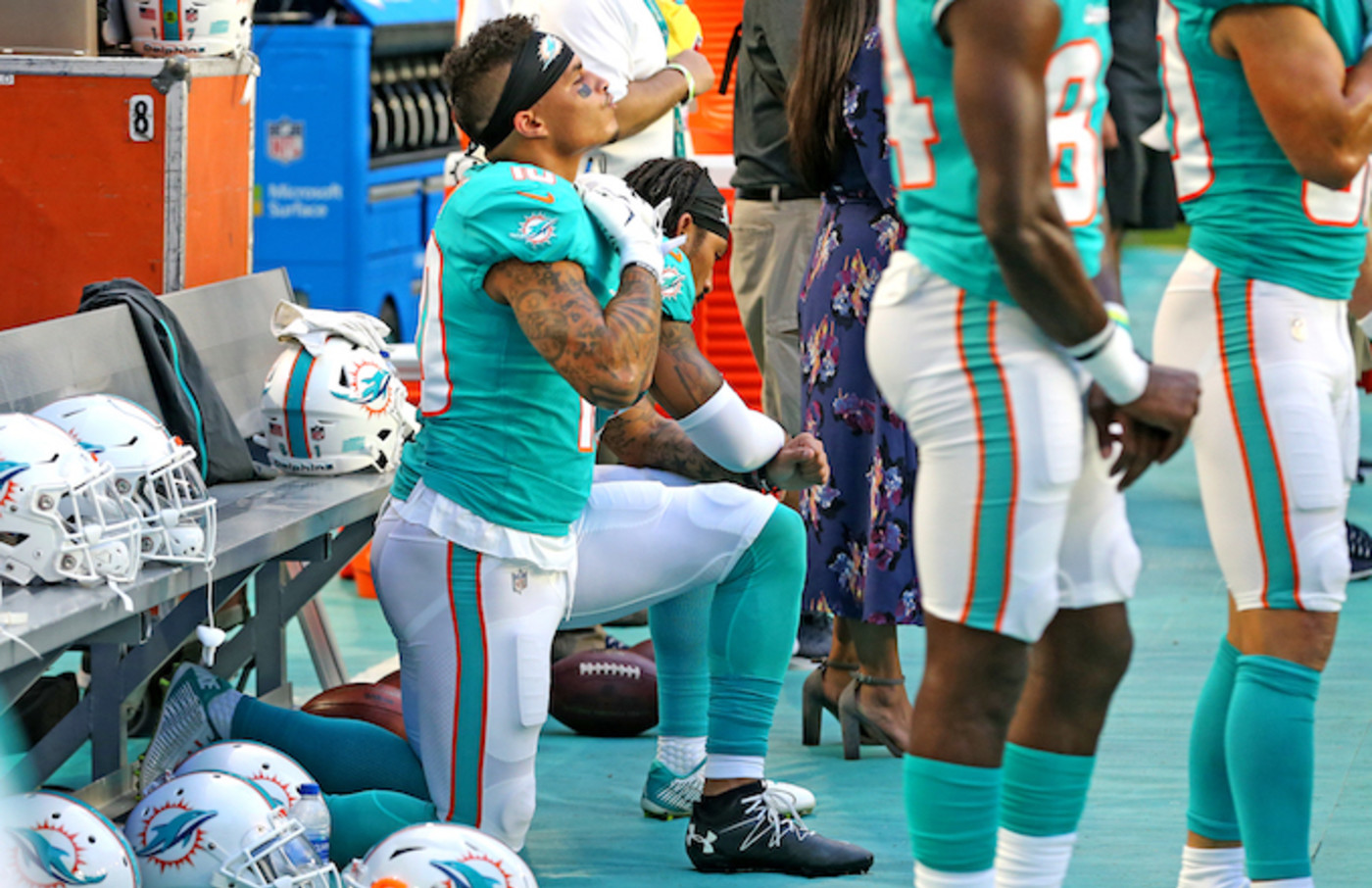 Kenny Stills and Albert Wilson kneel during the national anthem.
