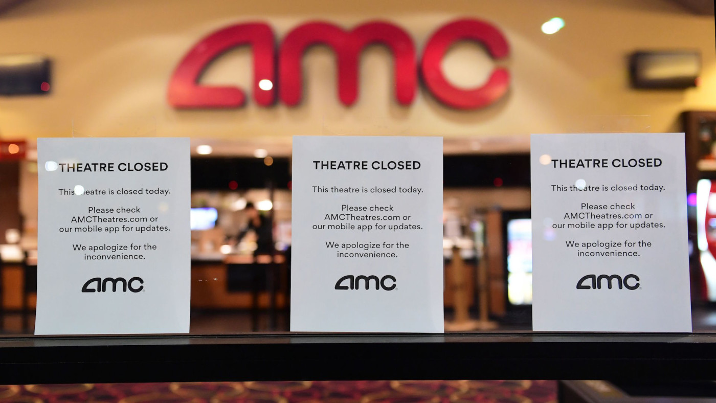 """Theater Closed"" signs are posted in front of the AMC Montebello."