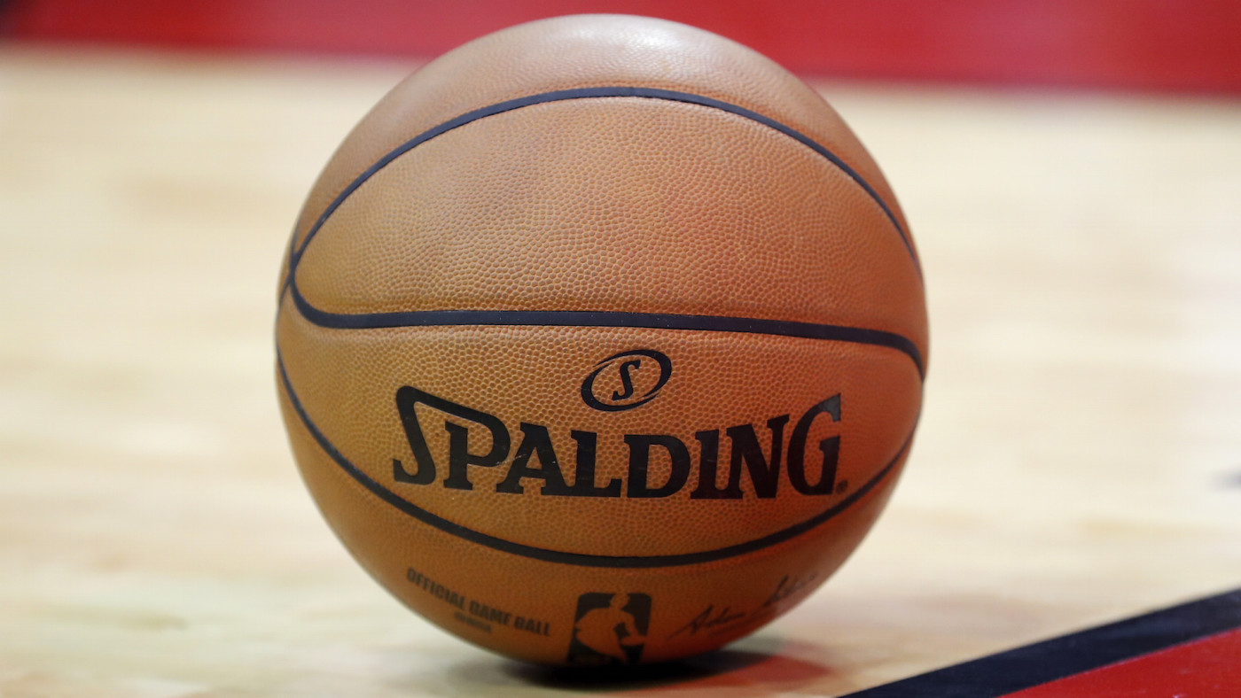 A Spalding basketball is seen on the court