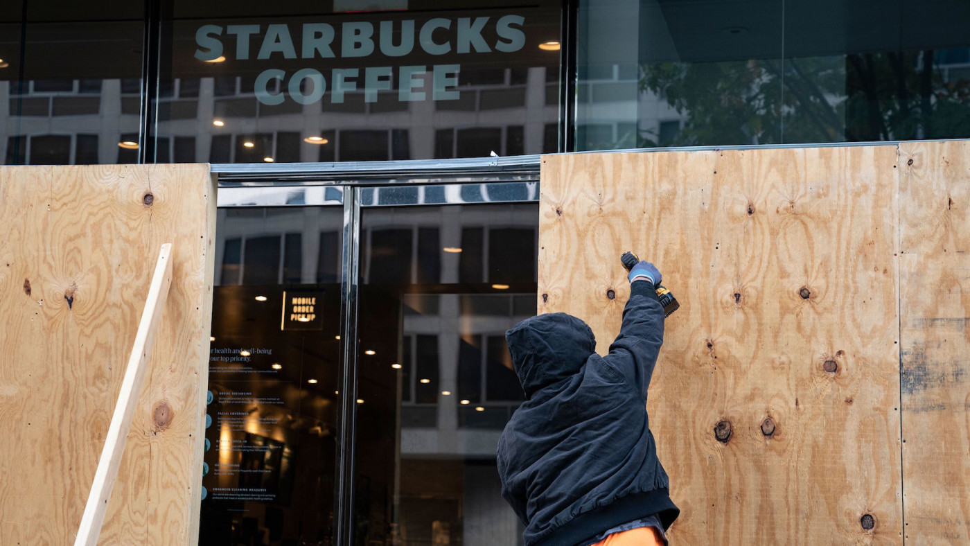 Wooden boards protect a Starbucks location near the White House