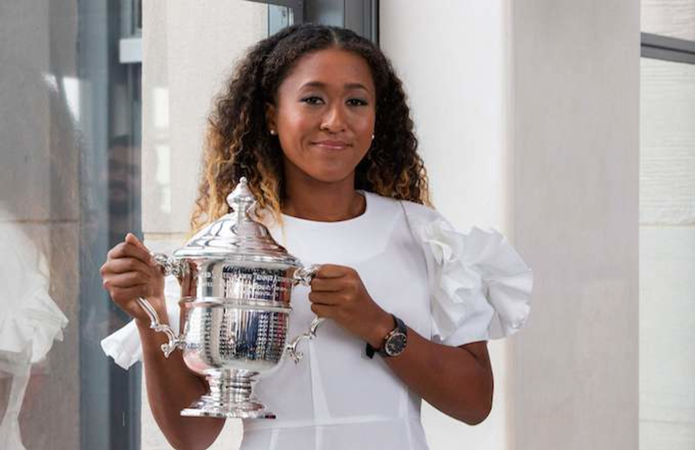 Naomi Osaka of Japan poses with her championship trophy.