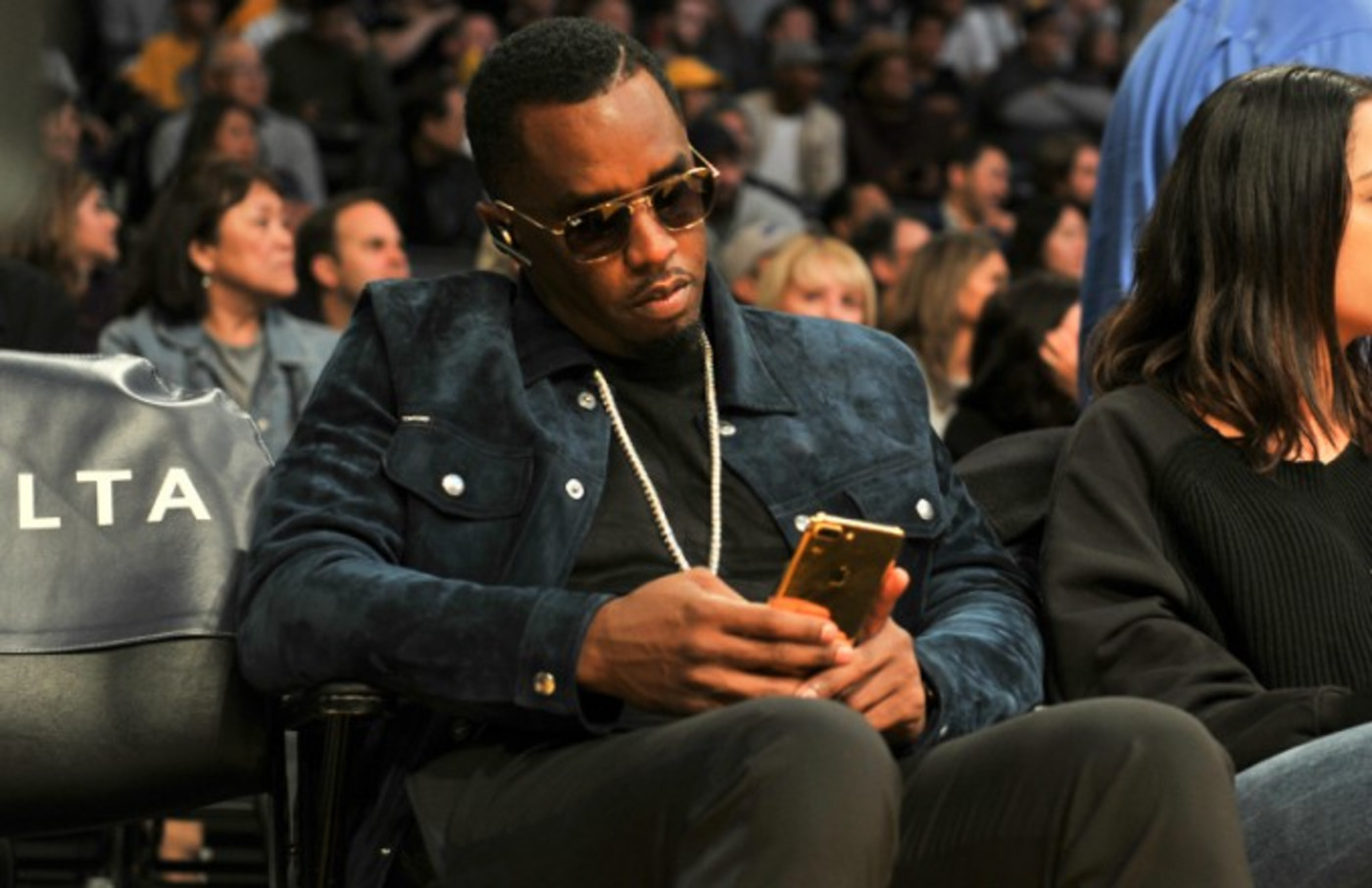 Diddy on phone.