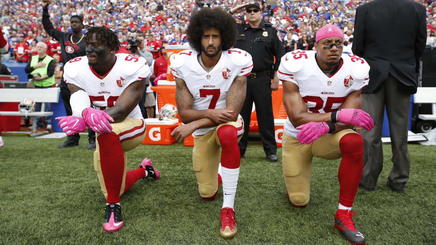 Eli Harold #58, Colin Kaepernick #7 and Eric Reid #35 of the San Francisco 49ers