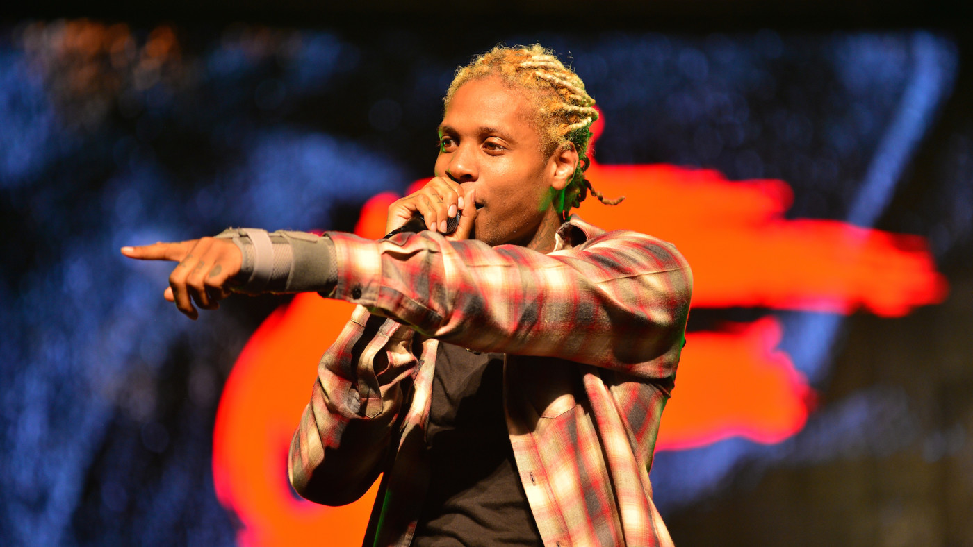 Lil Durk performs on stage at Watsco Center