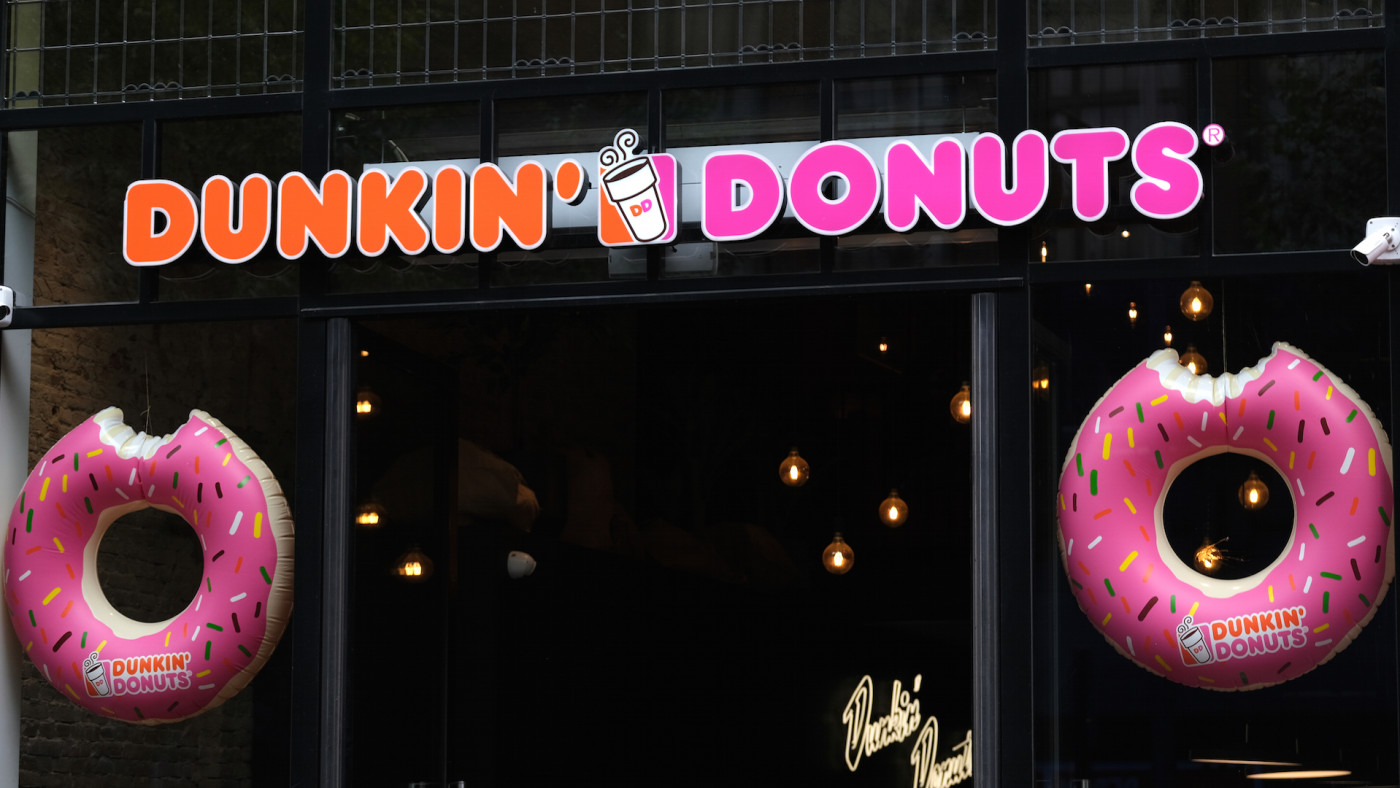 A logo of Dunkin' Donuts is seen at the entrance of its store