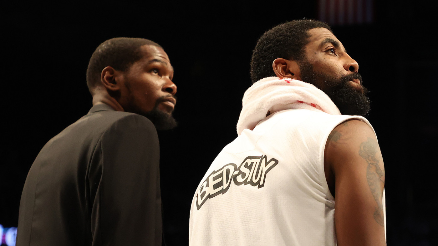 Kevin Durant and Kyrie Irving look on during their game against the Bucks.