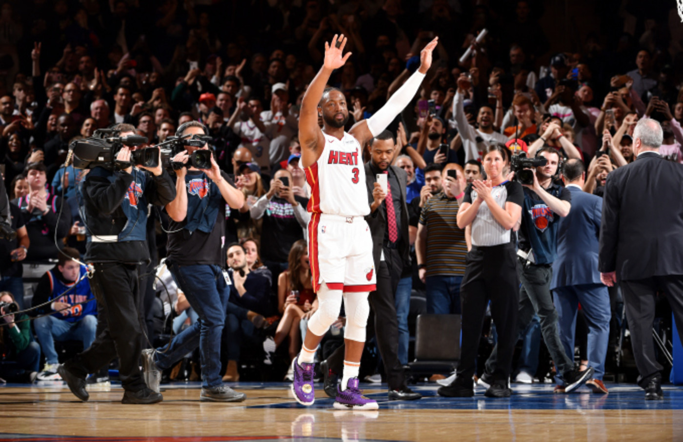 Dwyane Wade #3 of the Miami Heat gestures to the crowd