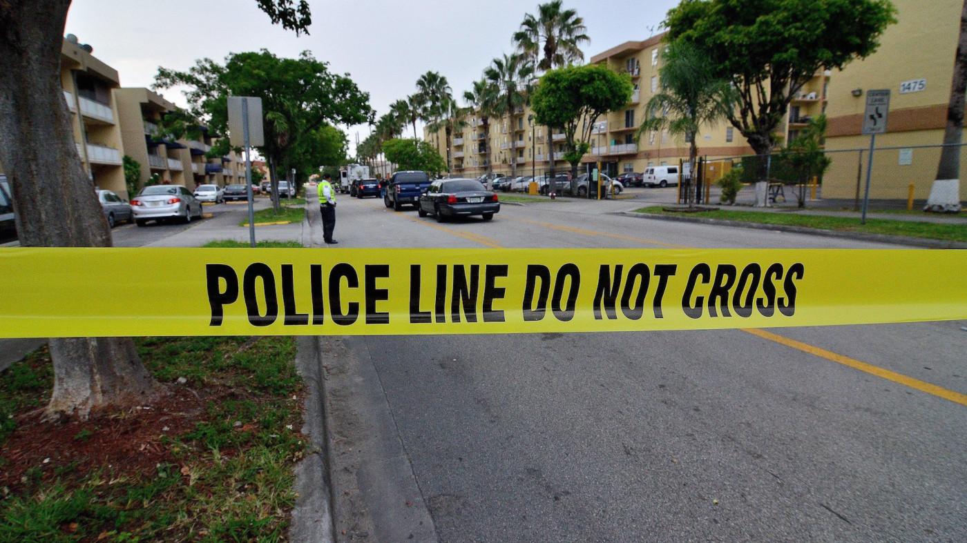 Police tape blocks the street