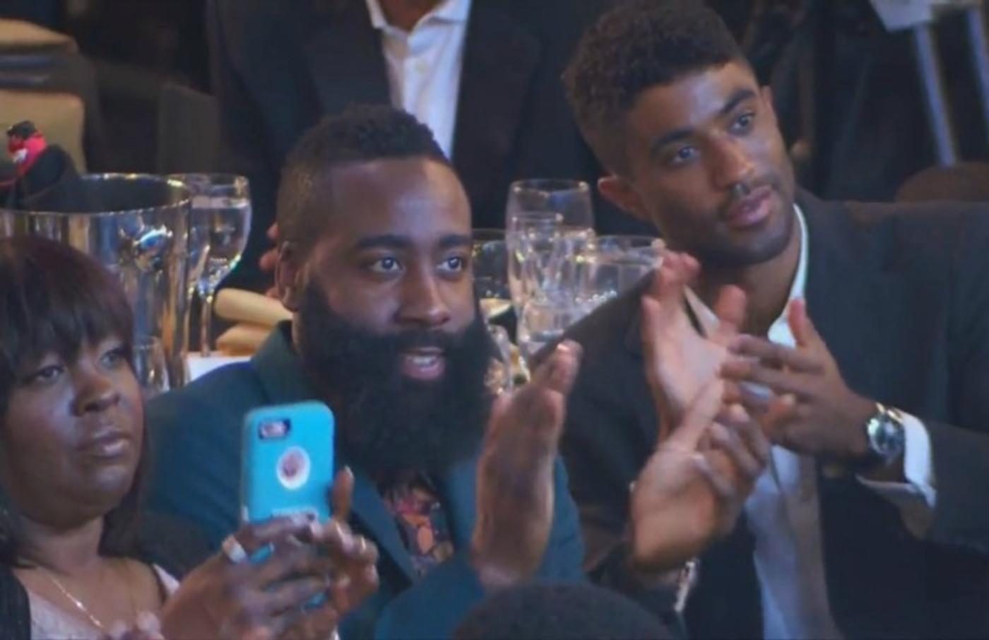 James Harden claps for Nicki Minaj.