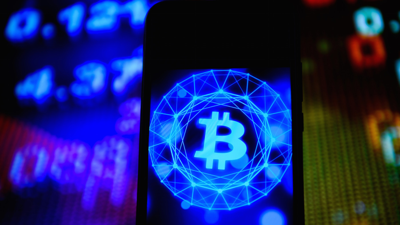 In this photo illustration a Bitcoin logo