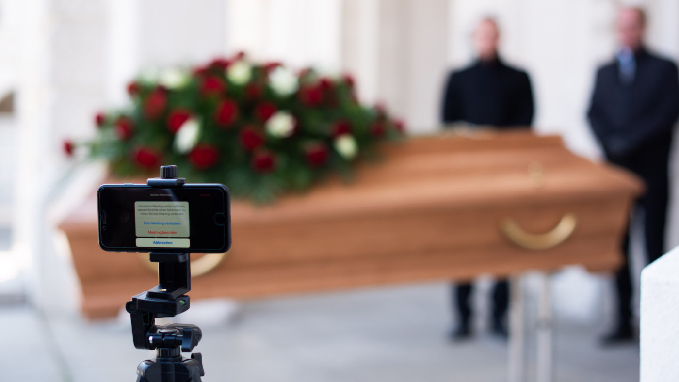 Employees of Bestattung Himmelblau undertakers rehearse livestream of upcoming funeral.
