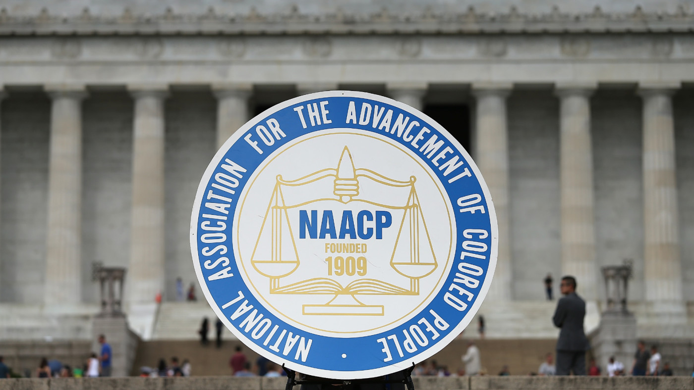 A logo is seen for the National Association for the Advancement of Colored People.