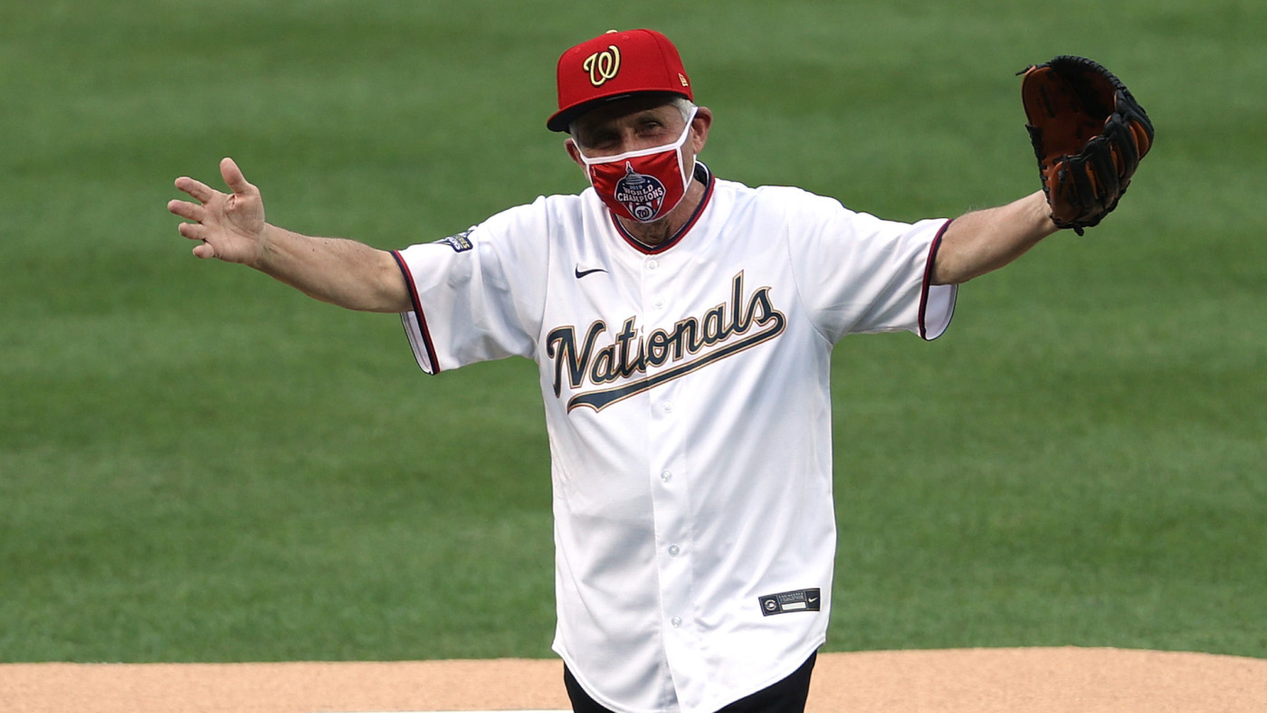 Dr. Anthony Fauci reacts after throwing out the ceremonial first pitch.