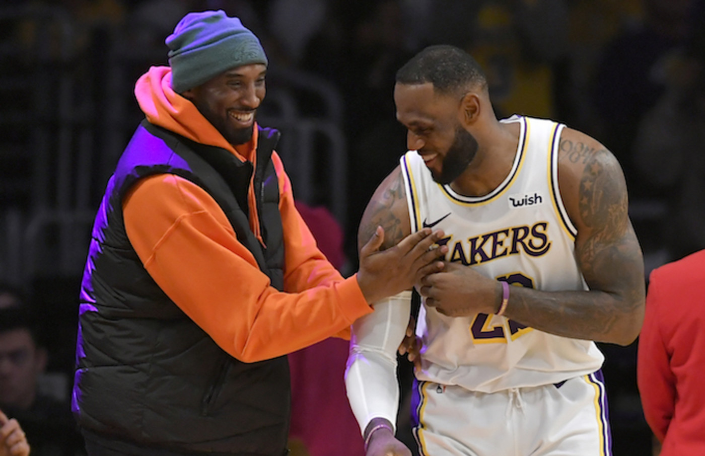 LeBron James has a moment on the sideline with former Laker Kobe Bryant.