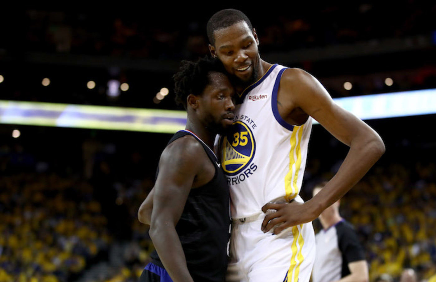 Patrick Beverley plays tight defense on Kevin Durant.