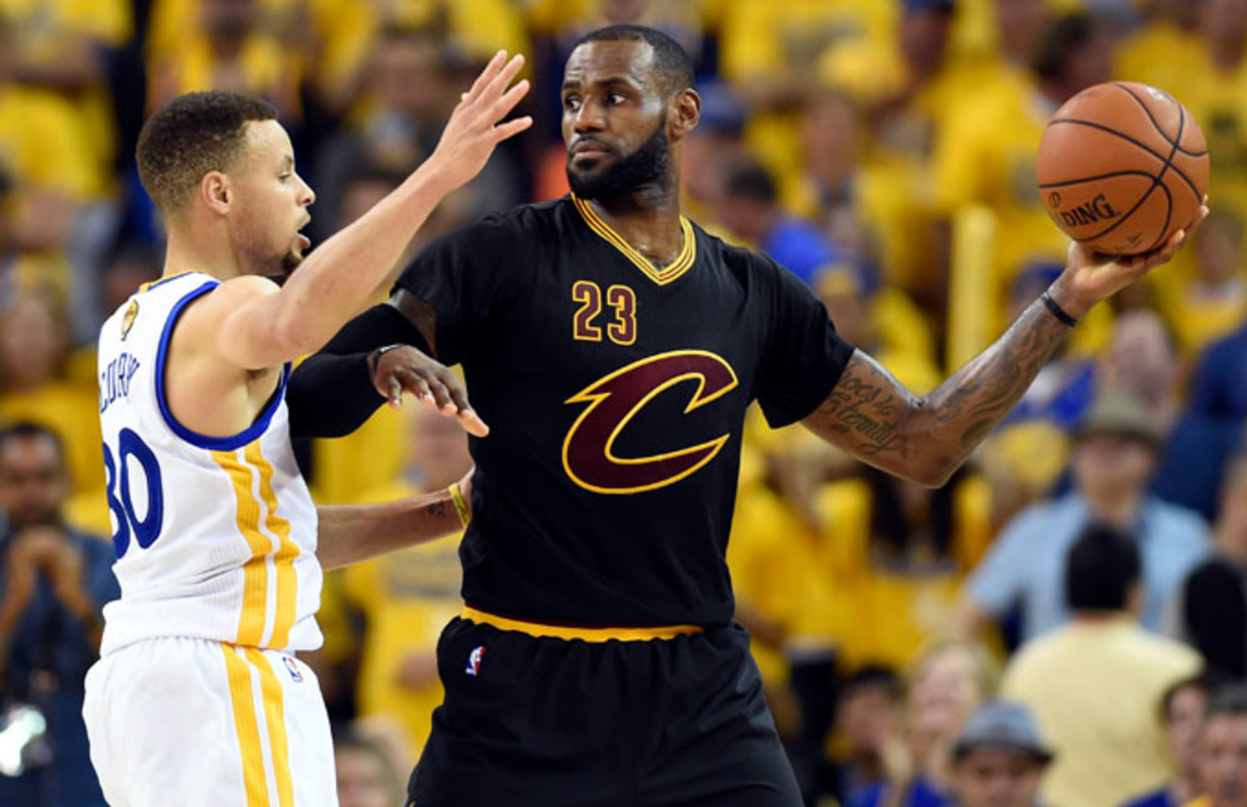 LeBron James holds the ball away from Stephen Curry during the 2016 NBA Finals.