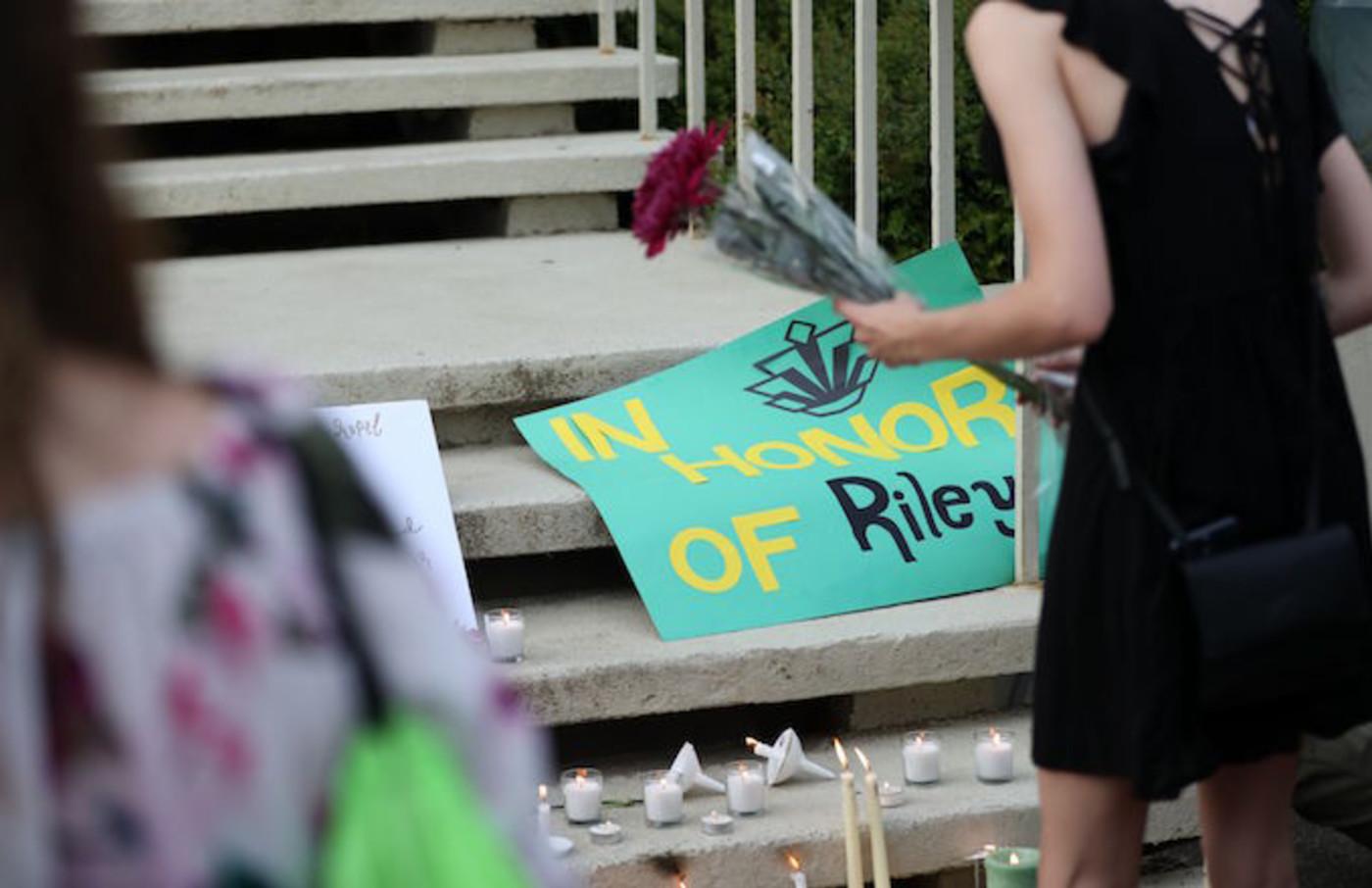 Students honor the victims of a shooting at the University of North Carolina Charlotte.