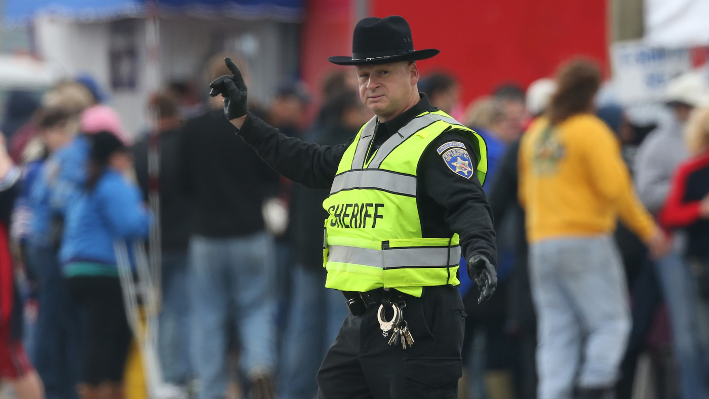 A sheriff directs traffic outside the stadium before the Buffalo Bills NFL game