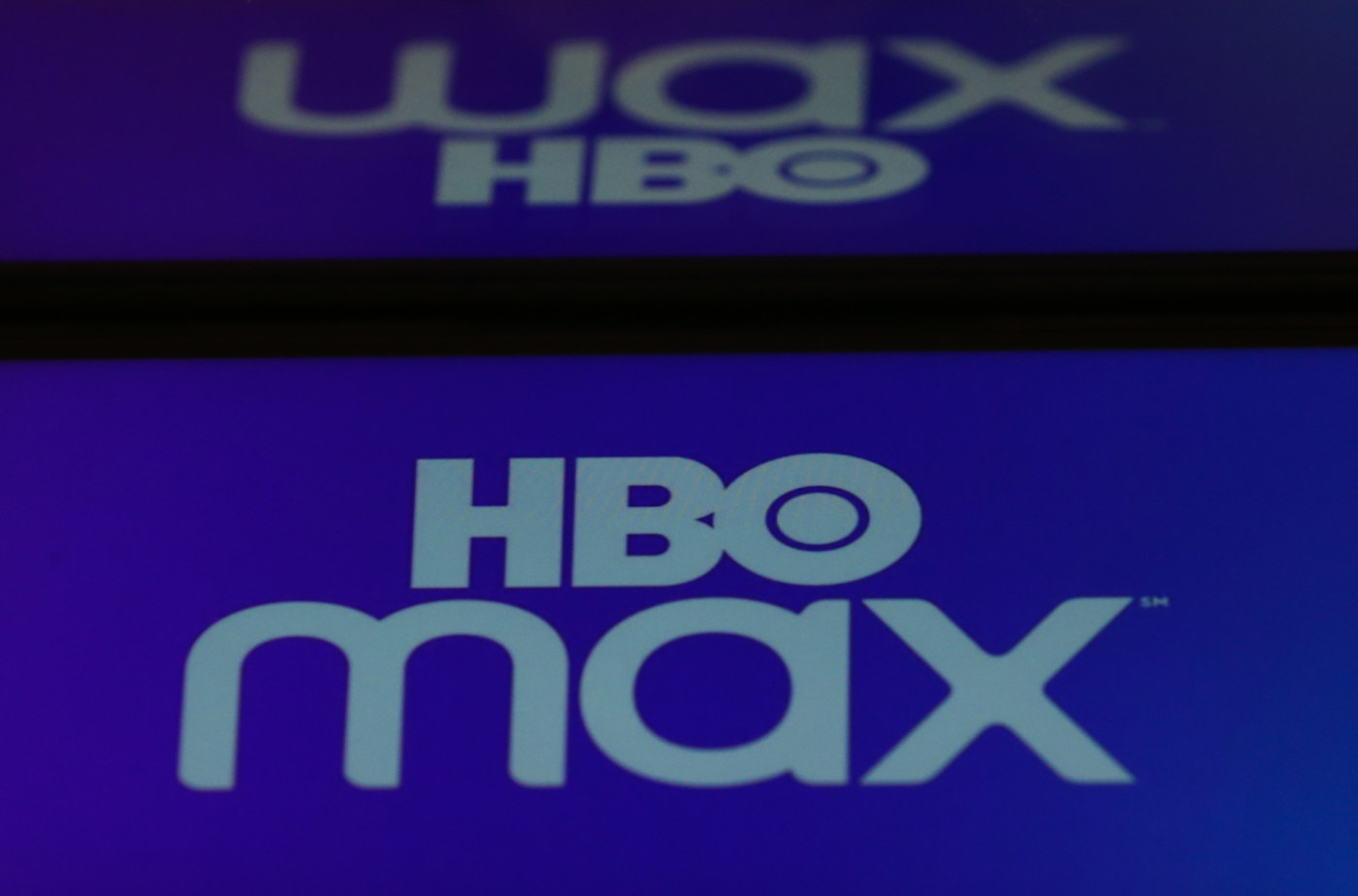 HBO Max logos are displayed on a mobile phone and a laptop screen
