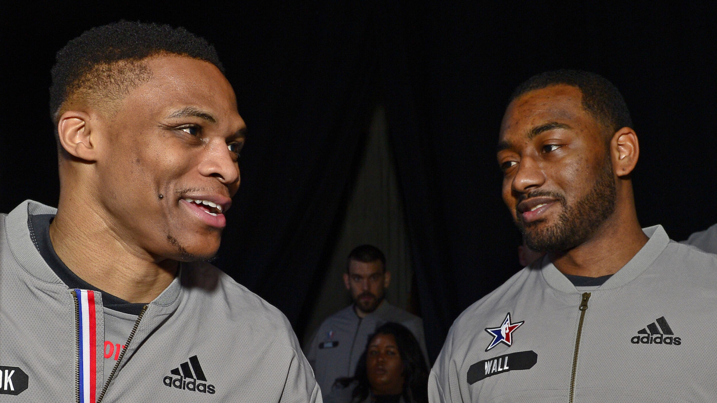 Russell Westbrook #0 of the Western Conference All-Star Team talks to John Wall.