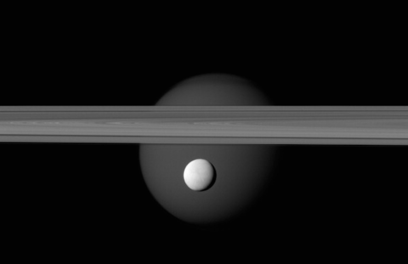 Enceladus appears before Saturn's rings