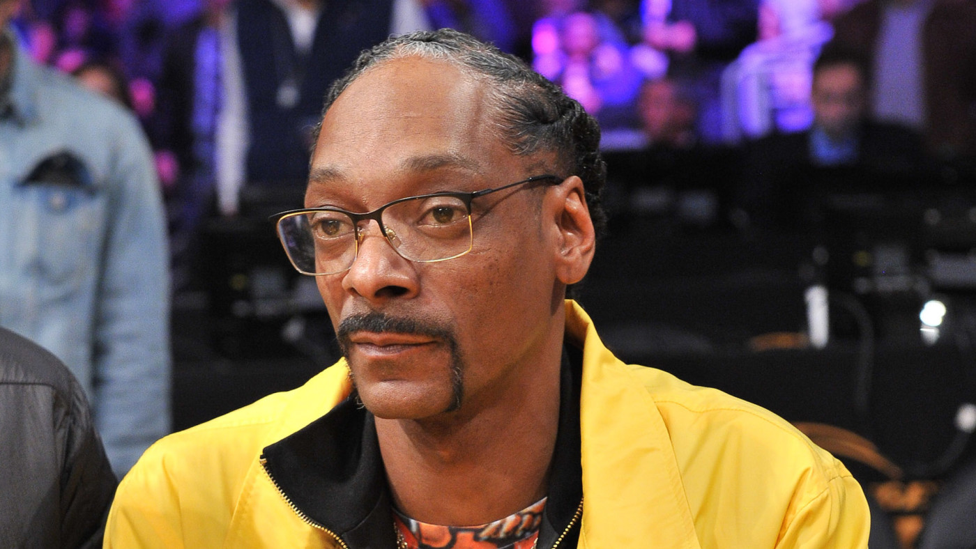 Snoop Dogg attends a basketball game