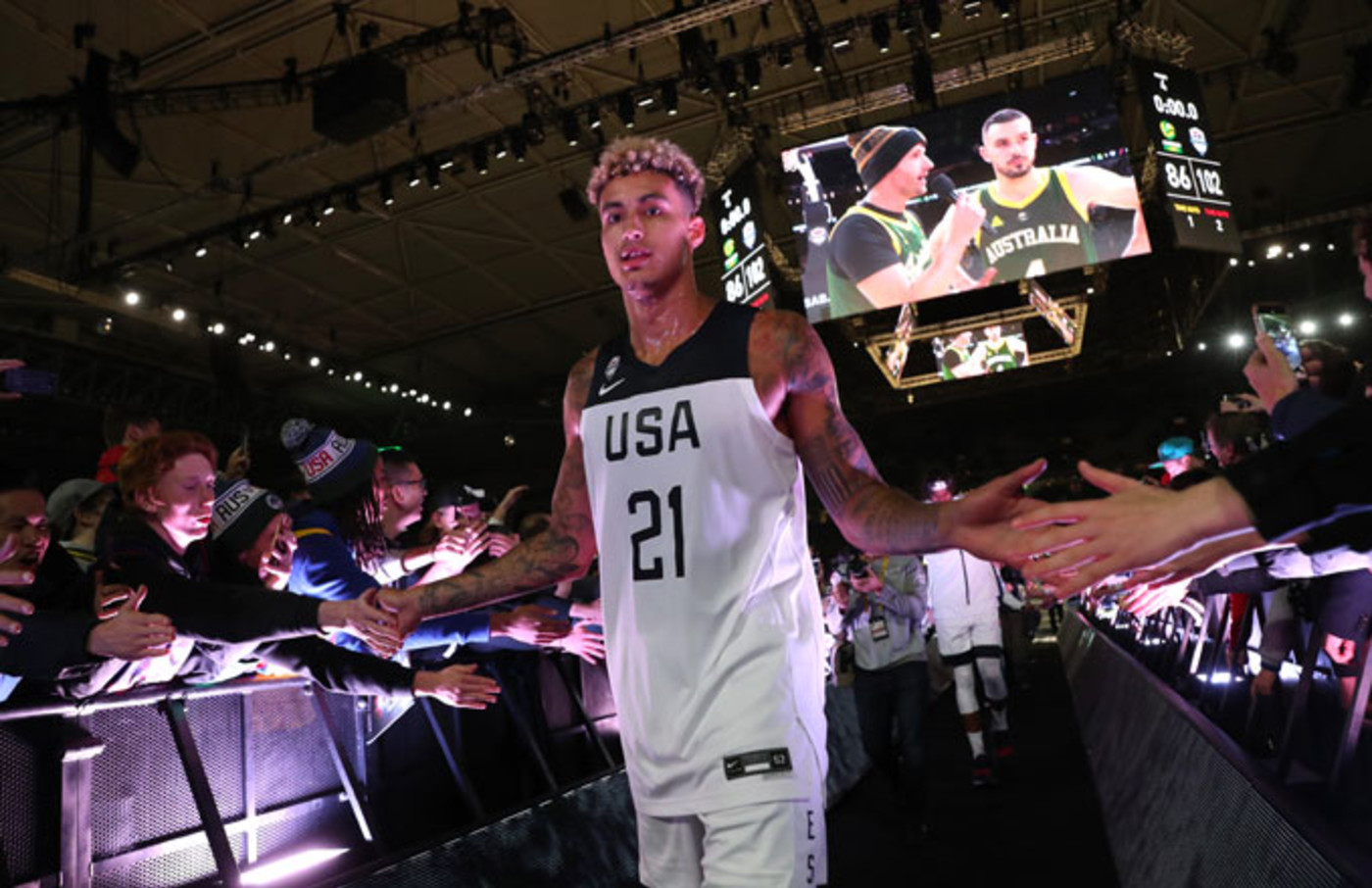Kyle Kuzma high fives fans of Team USA during an exhibition against Australia.