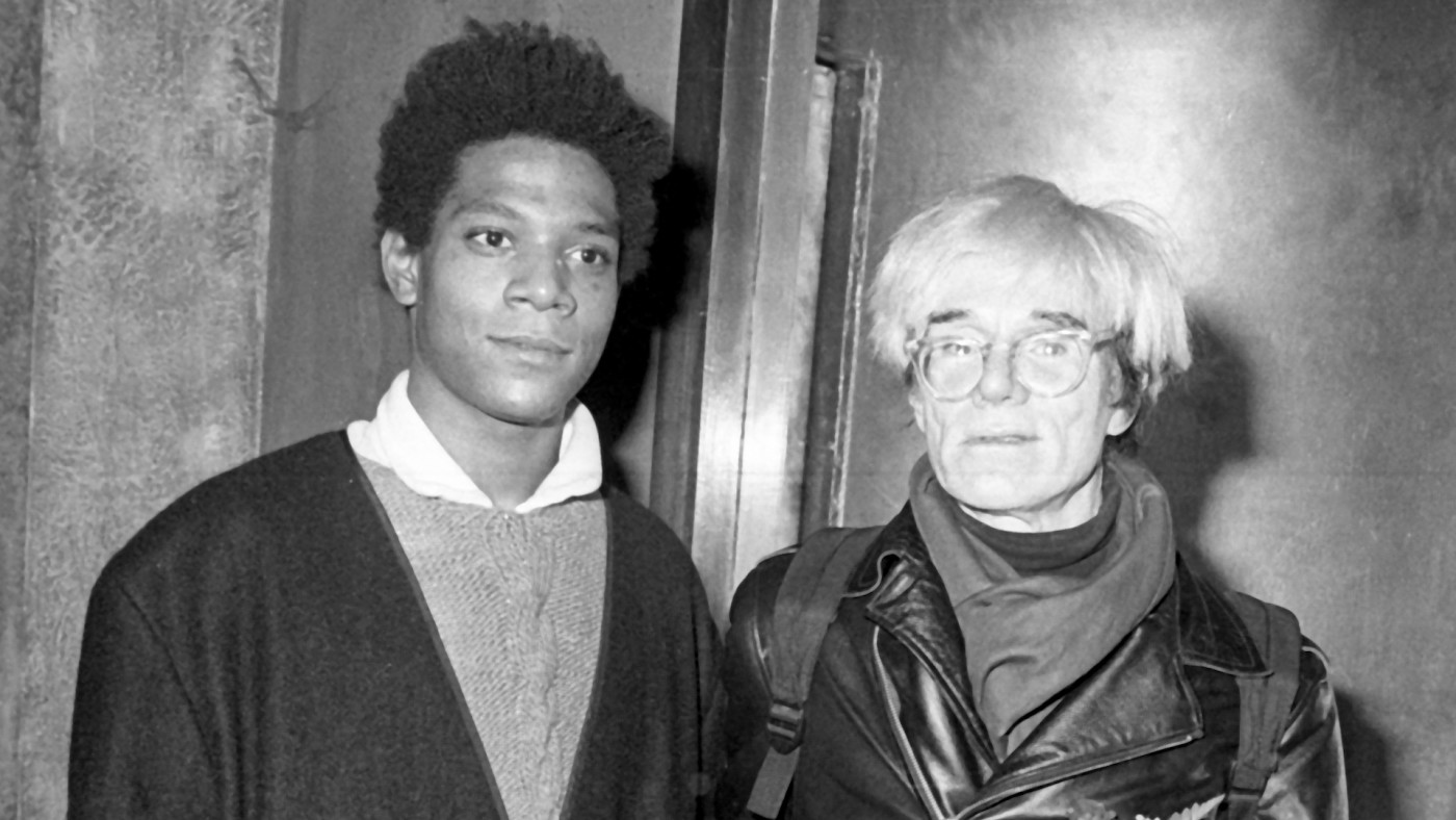 Jean-Michel Basquiat and Andy Warhol attend Gifts For The City Of New York Benefit.
