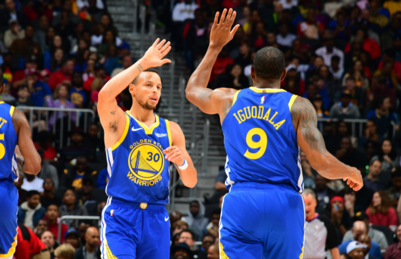 Stephen Curry #30 and Andre Iguodala #9 of the Golden State Warriors celebrates