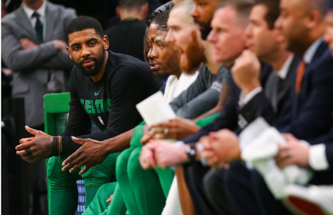 Kyrie Irving sits on the Celtics' bench