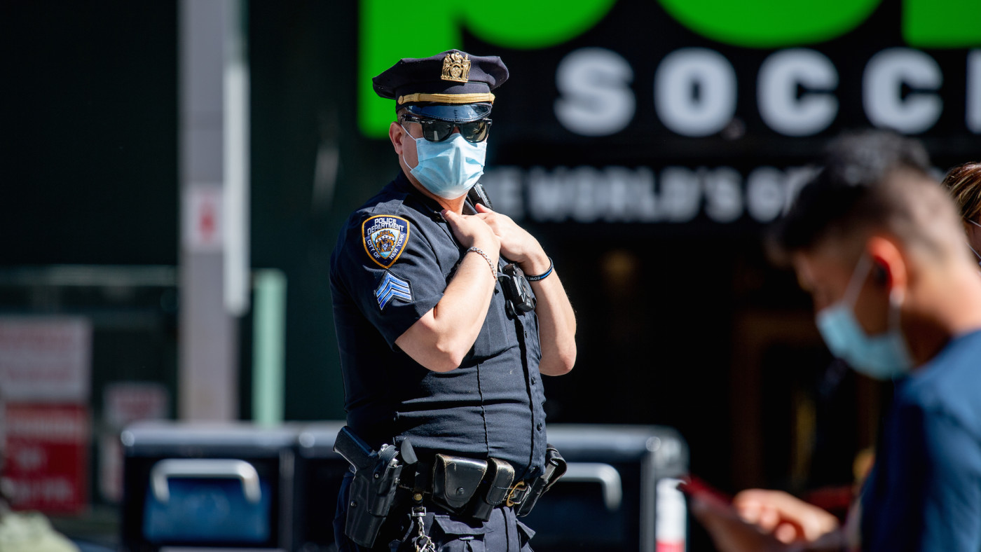 An NYPD police officer wears a mask in Times Square
