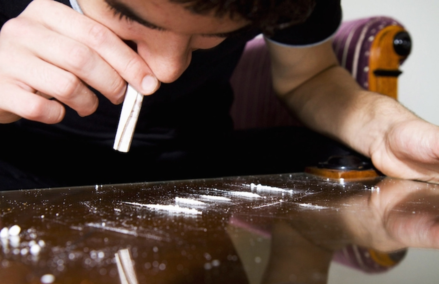 A person using cocaine.