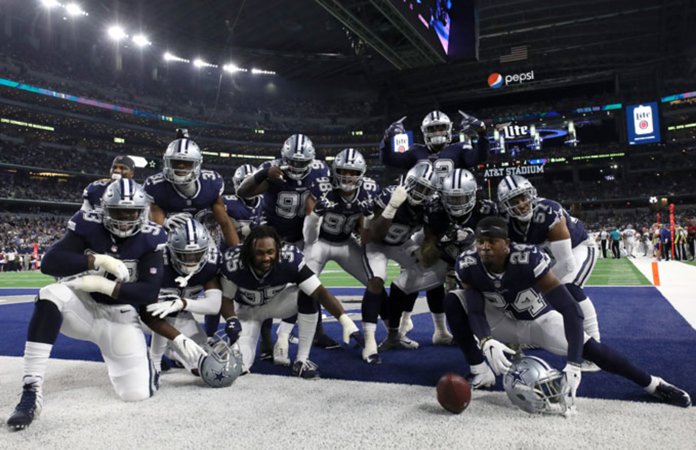 The Cowboys celebrate in the end zone after a score.