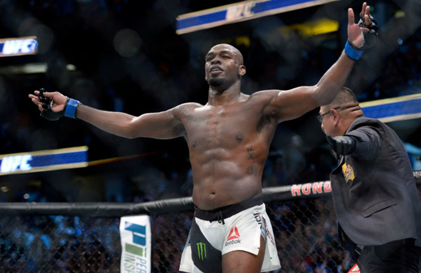 Jon Jones reacts following his victory against Daniel Cormier during UFC 214.