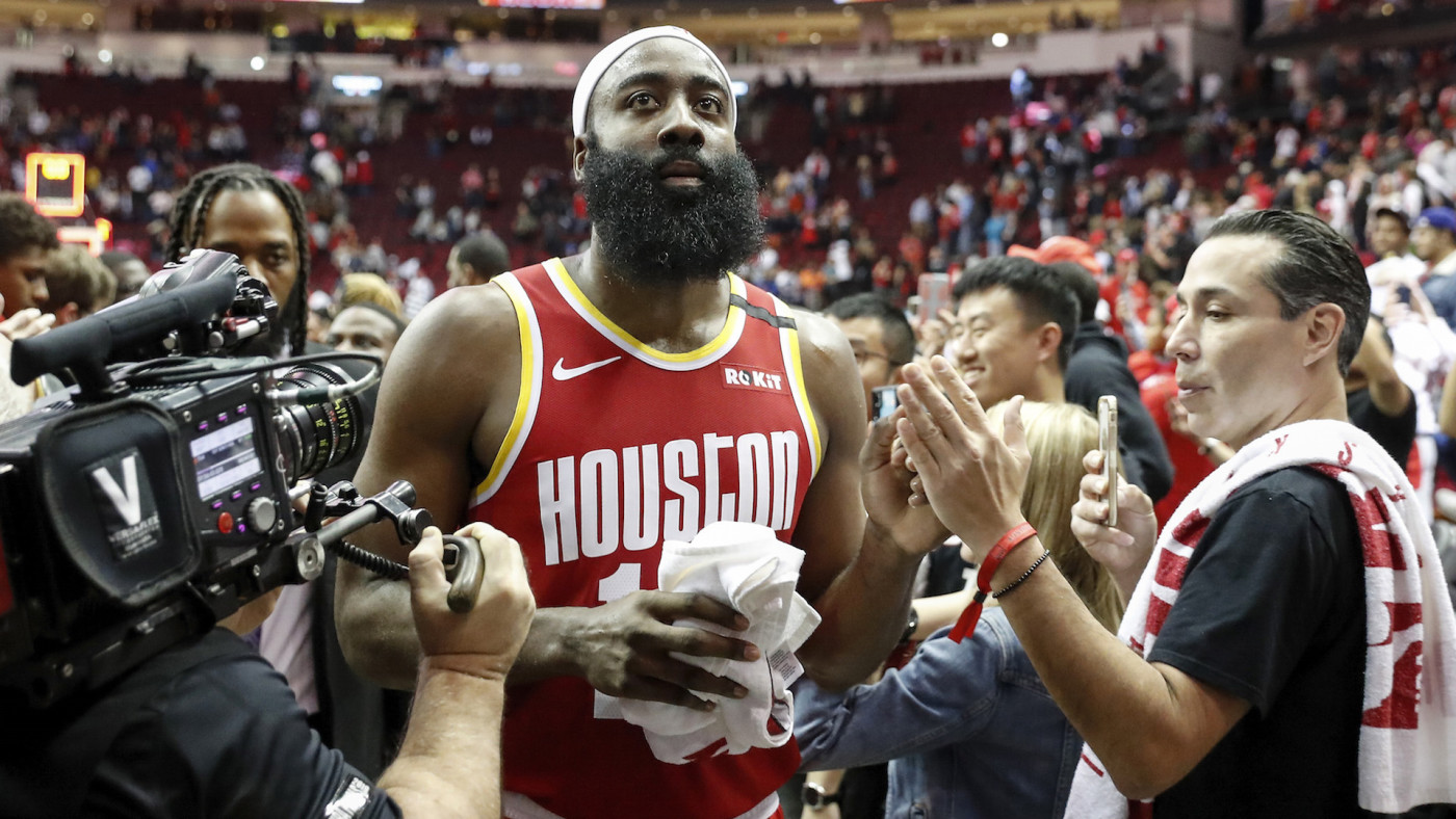 James Harden #13 of the Houston Rockets greets fans on the way to the locker room