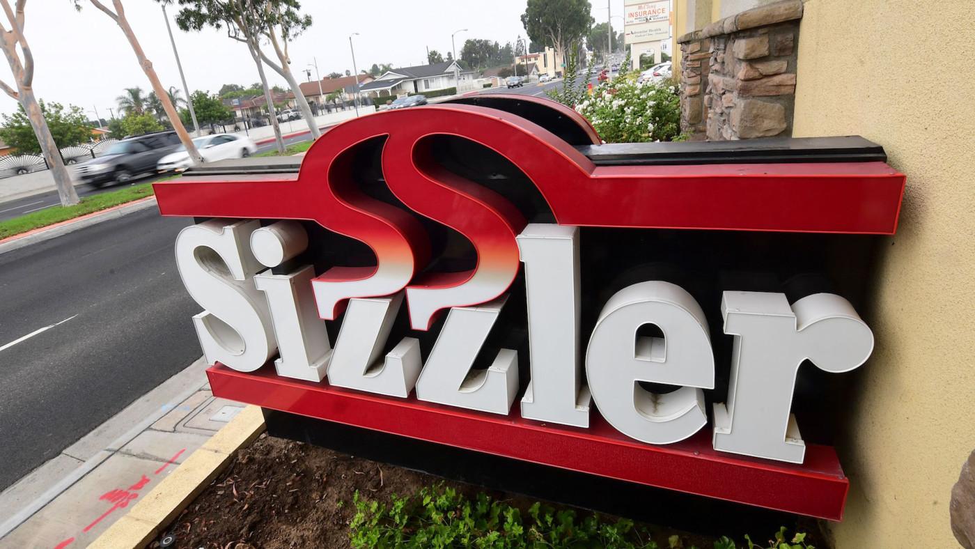 Commuters drive past a closed Sizzler restaurant in Montebello, California