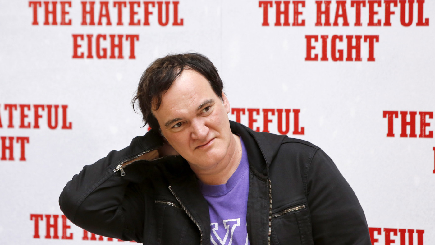 Quentin Tarantino poses during a photo call for his new movie 'The Hateful Eight.'
