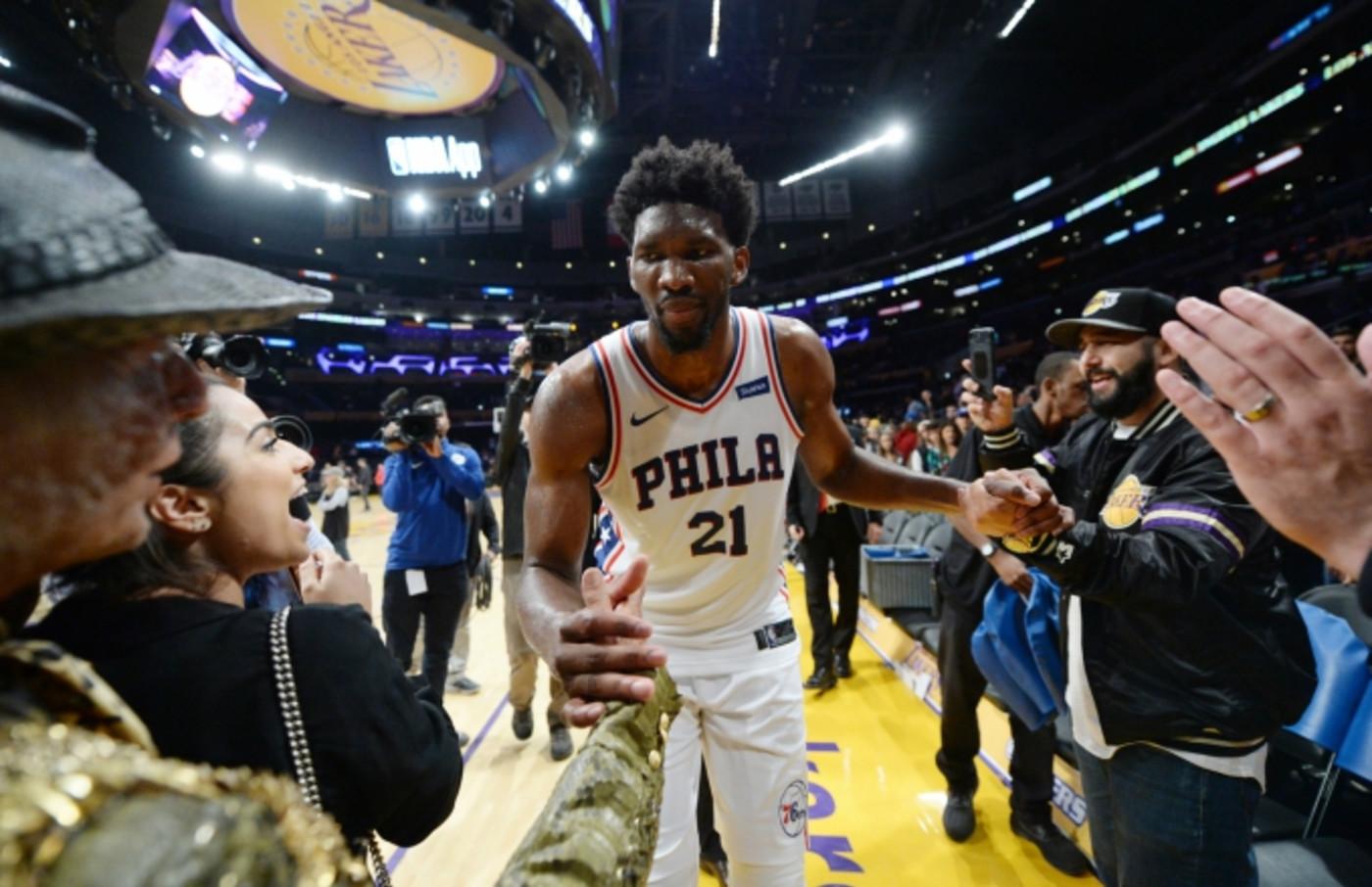 Joel Embiid celebrates win over Lakers.