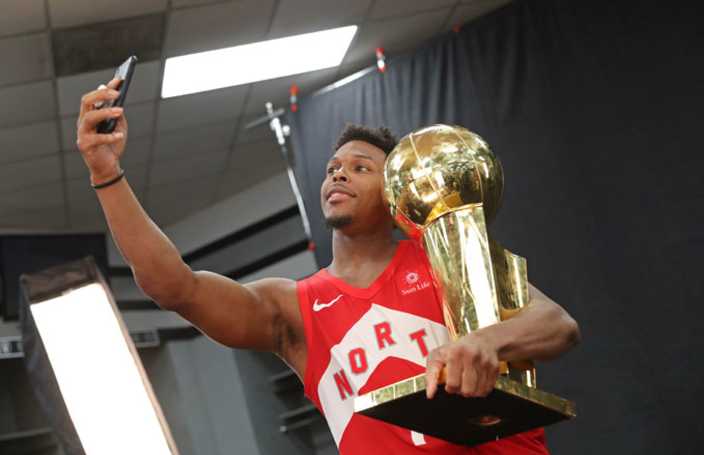 Kyle Lowry takes a selfie with the Larry O'Brien Trophy.