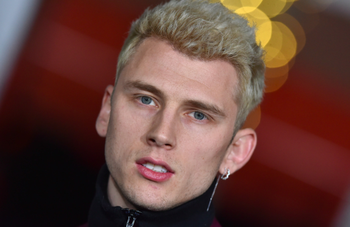 Rapper Machine Gun Kelly arrives at the premiere of Netflix's 'Bright'
