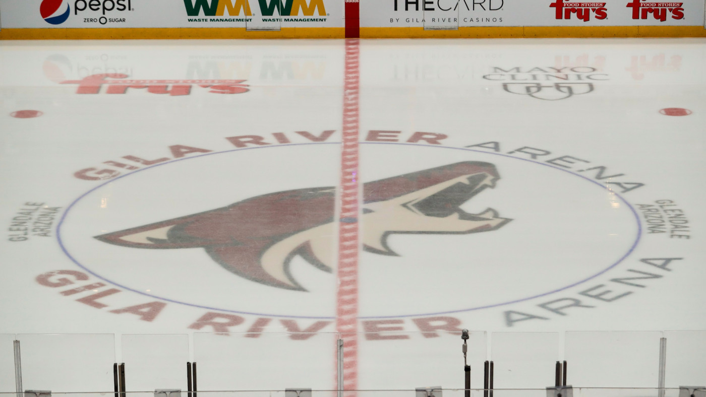 The Coyotes logo on the ice during the NHL hockey game against the Chicago Blackhawks.