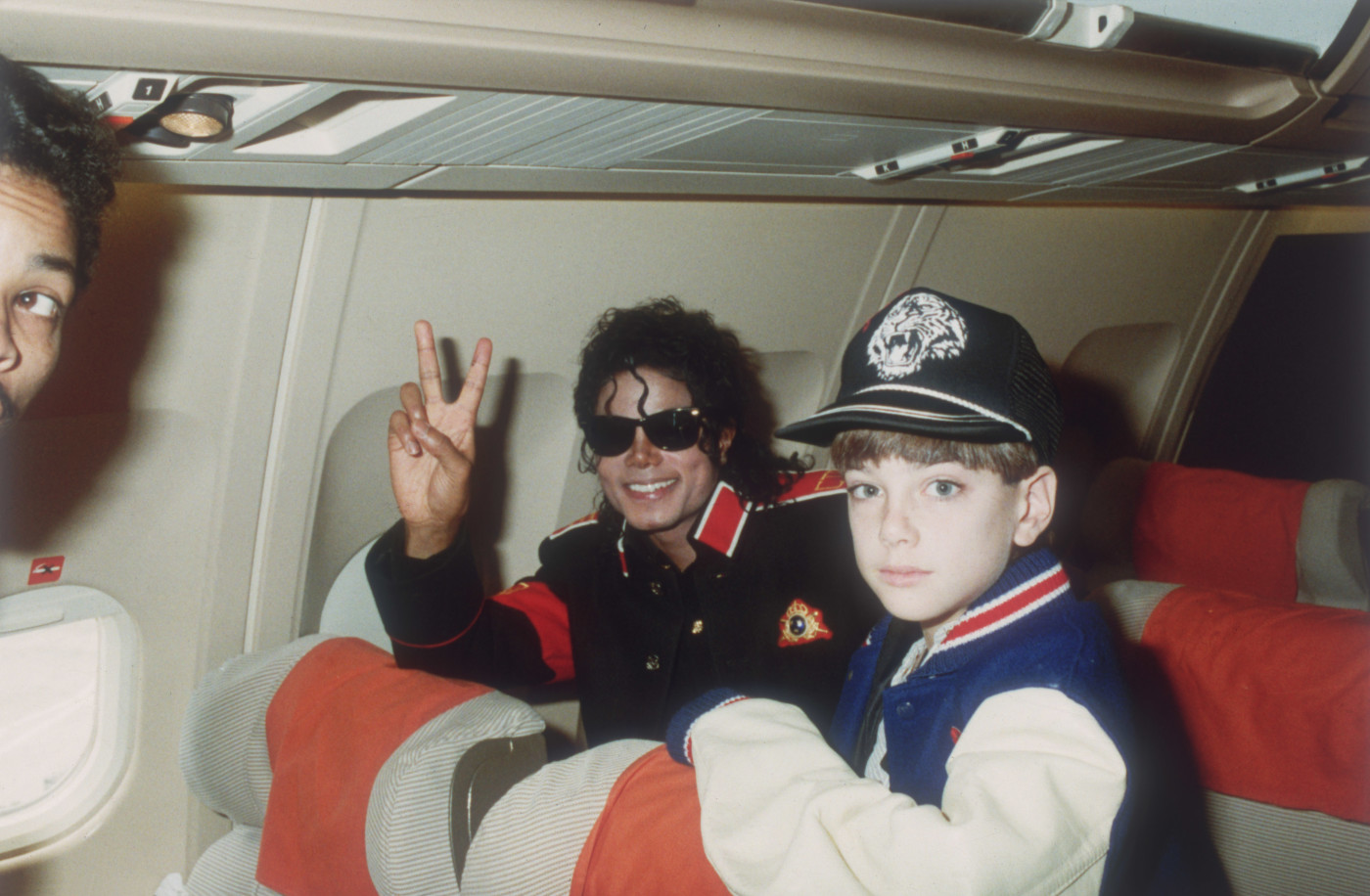 Michael Jackson with 10 year old Jimmy Safechuck on the tour plane