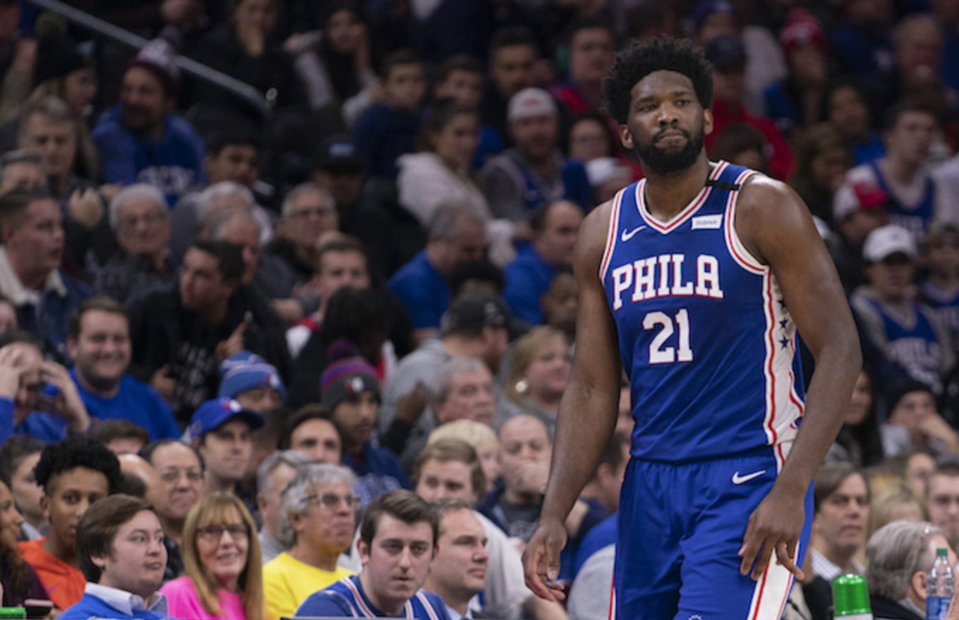 Joel Embiid #21 of the Philadelphia 76ers walks off the court after injuring his finger.