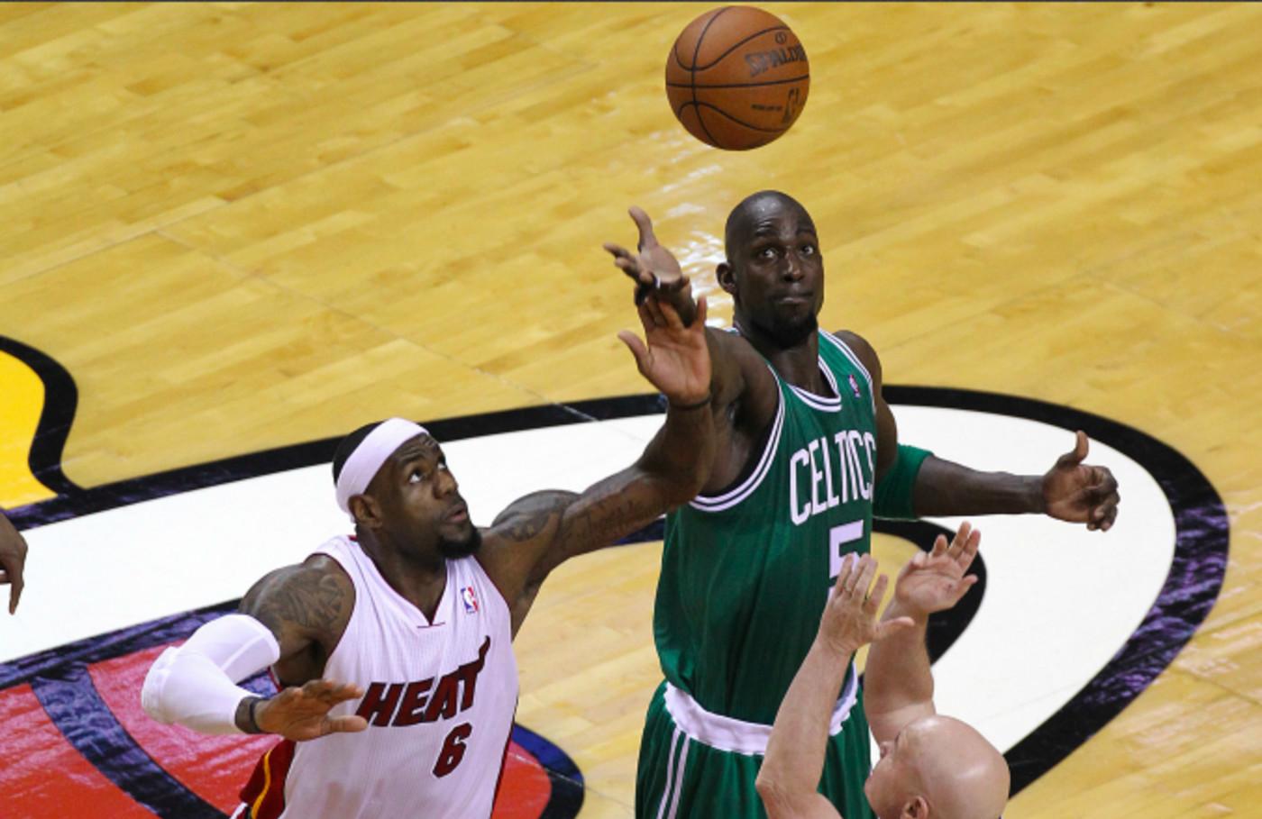 Boston Celtics power forward Kevin Garnett (#5) wins the opening tipoff