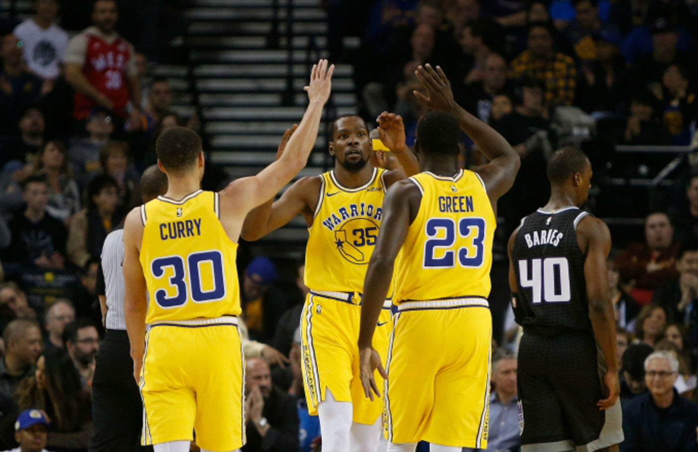 Kevin Durant #35 of the Golden State Warriors celebrates with teammates
