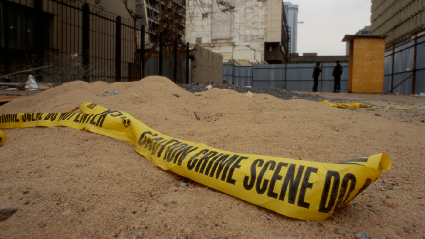 At the bombing site of the United States Embassy, crime scene tape lies on the ground.