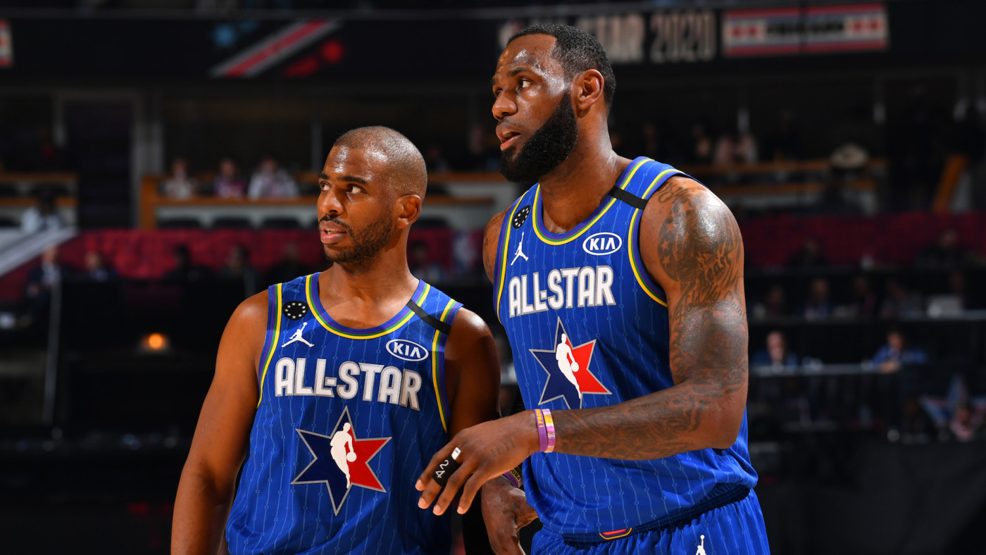 Chris Paul and LeBron James look on during the 69th NBA All-Star Game.