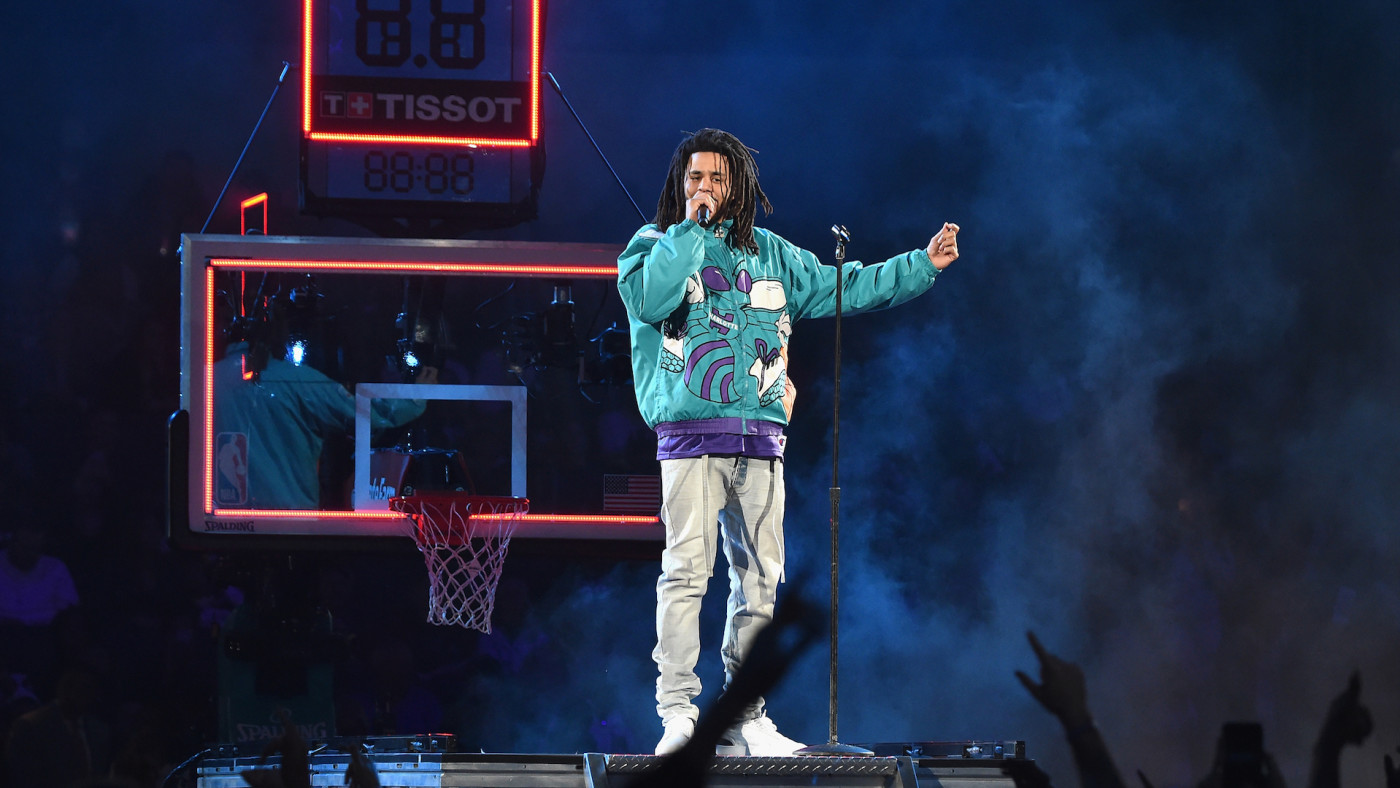 J. Cole performs at halftime during the 68th NBA All-Star Game